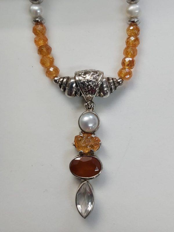 Item 105NS Spessartine with pendant